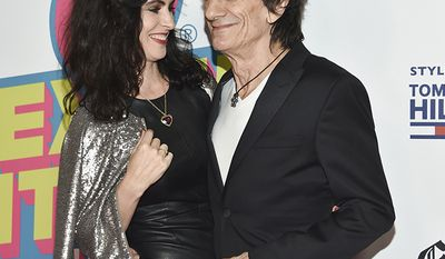 Rolling Stones guitarist Ronnie Wood, 69, and wife Sally, 38, had twin girls in 2016