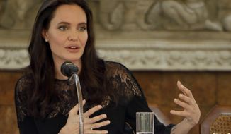 "Hollywood actress Angelina Jolie gives a press conference in Siem Reap province, Cambodia, Saturday, Feb. 18, 2017. Jolie on Saturday launches her two-day film screening of ""First They Killed My Father"" in Angkor complex in Siem Reap province. (AP Photo/Heng Sinith)"