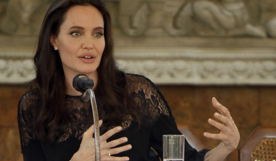 """Hollywood actress Angelina Jolie gives a press conference in Siem Reap province, Cambodia, Saturday, Feb. 18, 2017. Jolie on Saturday launches her two-day film screening of """"First They Killed My Father"""" in Angkor complex in Siem Reap province. (AP Photo/Heng Sinith)"""