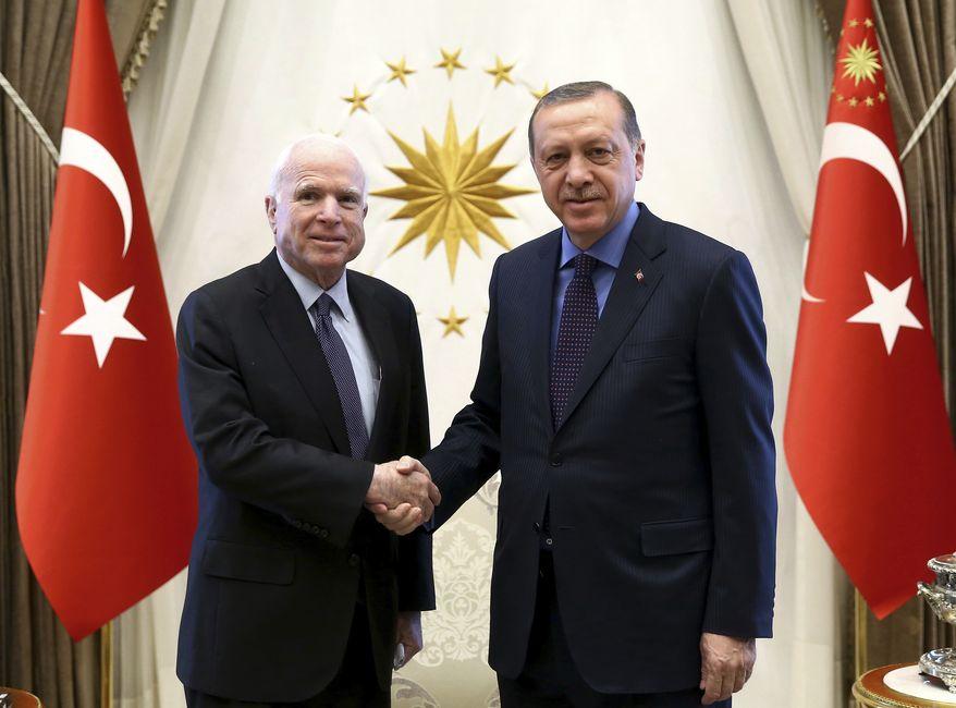 Turkey's President Recep Tayyip Erdogan, right, and U. S. Sen. John McCain, R-Ariz., shake hands prior to a meeting in Ankara, Turkey, Monday, Feb. 20, 2017. McCain met Erdogan after attiendng the Munich Security Conference 2017 in Munich, Germany. (Kayhan Ozer/Presidential Press Service, Pool via AP)