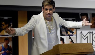 In this Jan. 25, 2017, file photo, Milo Yiannopoulos speaks on campus in the Mathematics building at the University of Colorado in Boulder, Colo. (Jeremy Papasso/Daily Camera via AP, File)