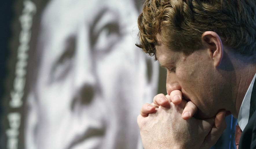 Rep. Joseph P. Kennedy III, D-Mass., listens during the dedication ceremony for the John F. Kennedy Centennial Stamp at the John F. Kennedy Library in Boston, Monday, Feb. 20, 2017. (AP Photo/Michael Dwyer)