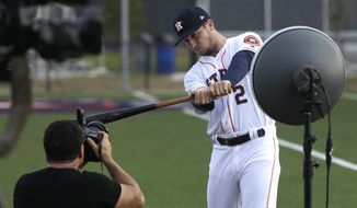 Houston Astros third baseman Alex Bregman (2) poses for a photographer during photo day before a spring training baseball workout Sunday, Feb. 19, 2017, in West Palm Beach, Fla. (AP Photo/David J. Phillip)