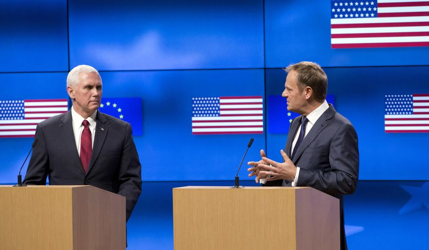United States Vice President Mike Pence, left, and European Council President Donald Tusk address a media conference at the EU Council building in Brussels on Monday, Feb. 20, 2017. U.S. Vice President Pence is currently on a two-day visit to meet with EU and NATO officials. (AP Photo/Virginia Mayo, Pool)