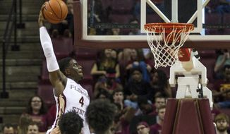 Florida State guard Dwayne Bacon Jr. dunks in the first half of an NCAA college basketball game against Boston College in Tallahassee, Fla., Monday, Feb. 20, 2017. (AP Photo/Mark Wallheiser)