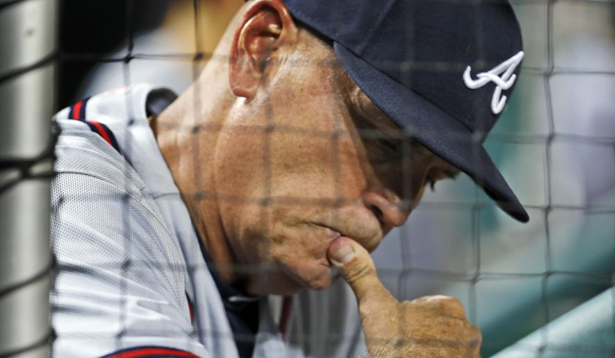 FILE - In this Aug. 12, 2016, file photo, Atlanta Braves interim manager Brian Snitker looks at his notes during a baseball game against the Washington Nationals at Nationals Park in Washington. With his career in baseball approaching four decades long, he figured there wasn't much chance of actually getting the call to the big leagues. But here he is _ finally, at the age of 61 _ getting ready for his first full season as manager of the Atlanta Braves. (AP Photo/Alex Brandon, File)