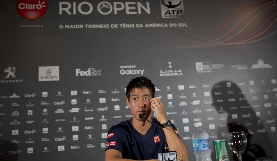 Japan's Kei Nishikori listens to a question during a press conference at the Rio Open tennis tournament in Rio de Janeiro, Brazil, Monday, Feb. 20, 2017. (AP Photo/Silvia Izquierdo)