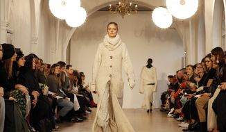 A model wears a creation by Pringle of Scotland during their Autumn/Winter 2017 show as part of London Fashion Week in London, Monday, Feb. 20, 2017. (AP Photo/Kirsty Wigglesworth)