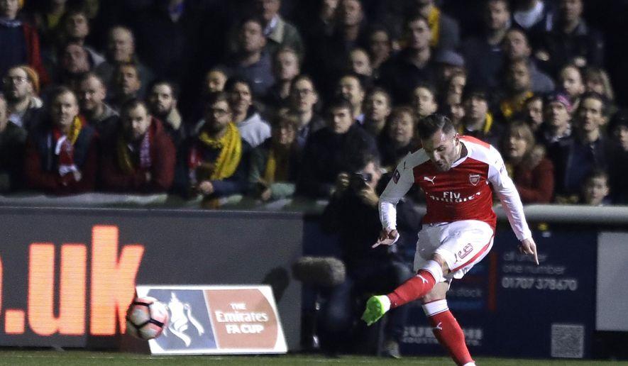 Arsenal's Lucas Perez kicks the ball to score a goal during their English FA Cup fifth round soccer match against Sutton United at Gander Green Lane stadium in London, Monday, Feb. 20, 2017. (AP Photo/Matt Dunham)