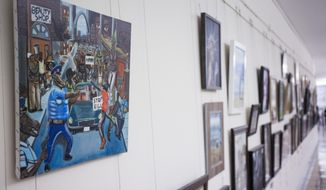 FILE - In this Jan. 5, 2017, photo, a painting by David Pulphus is shown hung in a hallway displaying paintings by high school students selected by their member of congress on Capitol Hill in Washington.  The office of Missouri Democratic Rep. William Lacy Clay has announced he intends to file a federal lawsuit Tuesday over the removal of a constituent's painting from its Capitol Hill display.   (AP Photo/Zach Gibson)