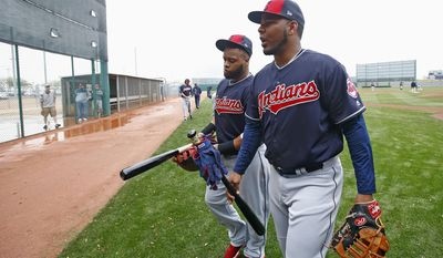 Cleveland Indians' Edwin Encarnacion, right, and Carlos Santana, left, walk off the practice field after workouts at the team's baseball spring training facility Sunday, Feb. 19, 2017, in Goodyear, Ariz. (AP Photo/Ross D. Franklin)