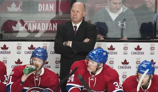 Montreal Canadiens head coach Claude Julien looks on during the third period of an NHL hockey game against the Winnipeg Jets in Montreal, Saturday, Feb. 18, 2017. (Graham Hughes/The Canadian Press via AP)