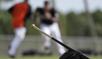 Miami Marlins players run the bases during a spring training baseball workout Saturday, Feb. 18, 2017, in Jupiter, Fla. (AP Photo/David J. Phillip)