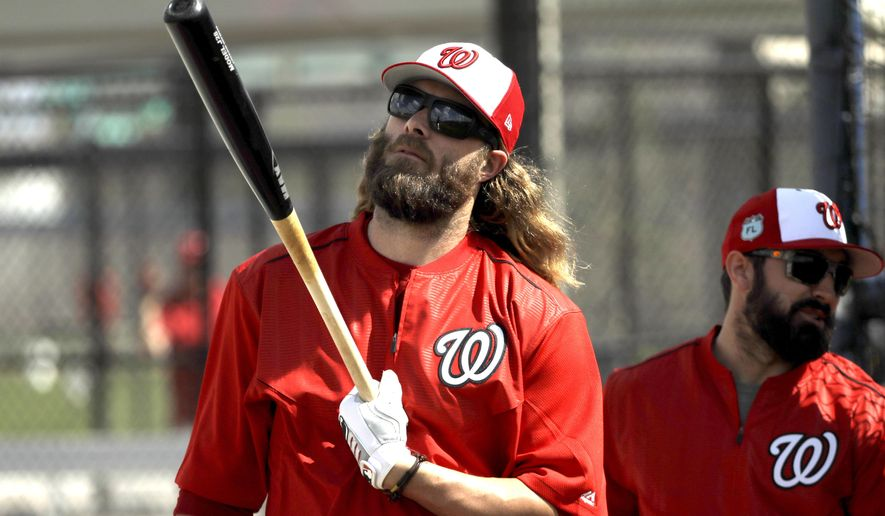 Washington Nationals left fielder Jayson Werth looks at his bat during a spring training baseball workout Sunday, Feb. 19, 2017, in West Palm Beach, Fla. (AP Photo/David J. Phillip)
