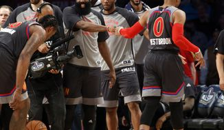 Western Conference guard Russell Westbrook of the Oklahoma City Thunder (0) is greeted by teammates during the second half of the NBA All-Star basketball game in New Orleans, Sunday, Feb. 19, 2017. (AP Photo/Max Becherer)