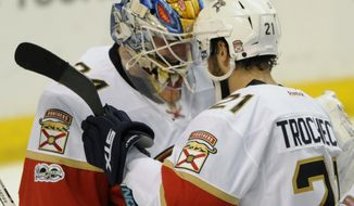 Florida Panthers' goalie James Reimer, left, is congratulated by teammate Vincent Trochck (21) after their 2-1 victory over the St. Louis Blues in an NHL hockey game, Monday, Feb. 20, 2017, in St. Louis. (AP Photo/Bill Boyce)