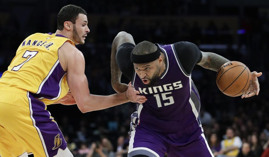 FILE - In this Tuesday, Feb. 14, 2017, file photo, Sacramento Kings' DeMarcus Cousins, right, drives past Los Angeles Lakers' Larry Nance Jr. during the second half of an NBA basketball game in Los Angeles. A person familiar with the situation said Sunday that the Sacramento Kings have agreed to trade Cousins and Omri Casspi to the New Orleans Pelicans in exchange for Tyreke Evans, 2016 first-round draft pick Buddy Hield, Langston Galloway and first- and second-round draft picks this summer. (AP Photo/Jae C. Hong, File)