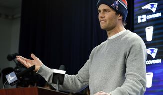 "FILE - In this Jan. 22, 2015, file photo, New England Patriots quarterback Tom Brady speaks at a news conference in Foxborough, Mass. Brady did not attend a 2015 celebration at the White House because of what the he insisted was a ""family commitment"" but others speculated was because of some unflattering comments a spokesman for President Barack Obama made about the Deflategate scandal. (AP Photo/Elise Amendola, File)"