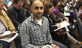 "In this Wednesday, Feb. 15, 2017 photo, Nareg Fradjian, of Pasadena, Calif., poses at a Los Angeles ceremony where he became a U.S. citizen. He said that while most people like Presidents Day for the sales, ""It's awesome to have that one designated day just to say 'Thank you.'"" (AP Photo/Amanda Lee Myers)"