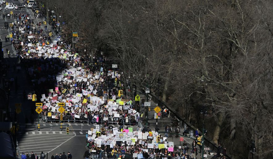 """A rally against Donald Trump stretches a few blocks along Central Park West in New York, Monday, Feb. 20, 2017. Demonstrators unhappy with President Donald Trump's policies attended a """"Not My Presidents Day"""" rally. (AP Photo/Seth Wenig)"""