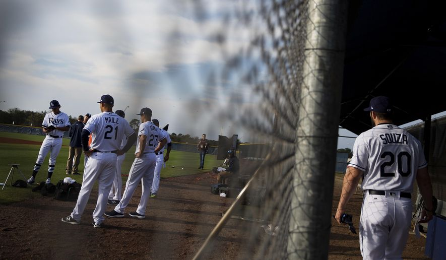 Tampa Bay Rays' Steven Souza Jr., right, joins teammates on the field waiting to have their picture taken during the team's photo day at baseball spring training in Port Charlotte, Fla., Saturday, Feb. 18, 2017. (AP Photo/David Goldman)