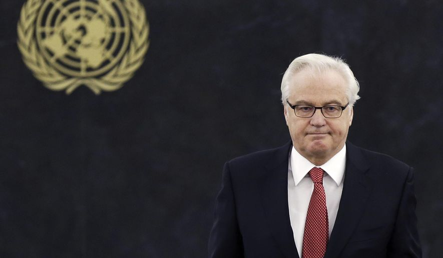 FILE - In this Thursday, March 27, 2014, file photo, Russian ambassador to the United Nations Vitaly Churkin returns to his seat after speaking at United Nations headquarters. Russian officials said Churkin died suddenly in New York City on Monday, Feb. 20, 2017. (AP Photo/Seth Wenig, File)