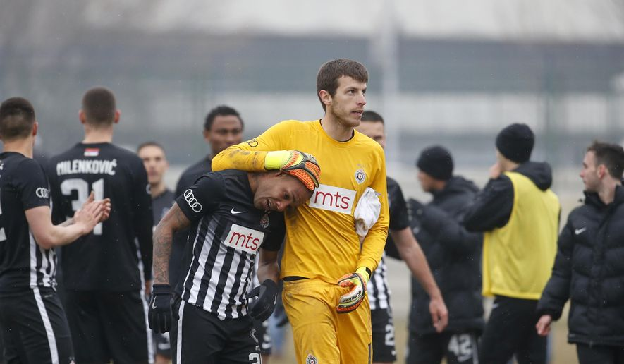 Partizan Belgrade's Brazilian player Everton Luiz, centre left, leaves the field accompanying by goalkeeper Filip Kljajic, during a Serbian championship match between Rad and Partizan, in Belgrade, Serbia, Sunday, Feb. 19, 2017. Luiz was in tears after suffering persistent racist chants during his team's 1-0 victory against Rad in the Serbian premiership. The Brazilian, who joined Partizan from the Swiss league in 2016, received monkey chants and other abuse, including a racist banner on the stands where Rad fans were standing. (AP Photo/Miroslav Todorovic)