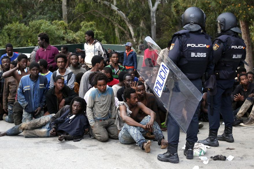 Migrants were captured by Spanish police after storming a fence to enter the Spanish enclave of Ceuta. Relentless waves of people have made the trek to the Spanish border seeking to escape the desperate poverty, terrorist violence, criminal bureaucracy and chaos of their respective countries in sub-Saharan and North Africa. (Associated Press/File)