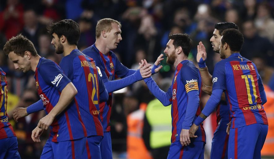 FC Barcelona's Lionel Messi, center right, celebrates after scoring during the Spanish La Liga soccer match between FC Barcelona and Leganes at the Camp Nou stadium in Barcelona, Spain, Sunday, Feb. 19, 2017. (AP Photo/Manu Fernandez)