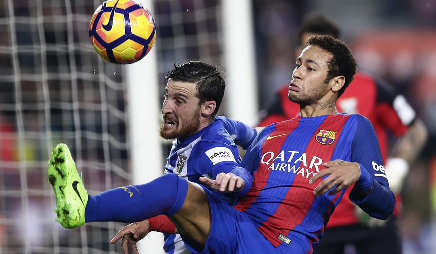 FC Barcelona's Neymar, right, duels for the ball against Leganes' Roberto Tito Roman during the Spanish La Liga soccer match between FC Barcelona and Leganes at the Camp Nou stadium in Barcelona, Spain, Sunday, Feb. 19, 2017. (AP Photo/Manu Fernandez)