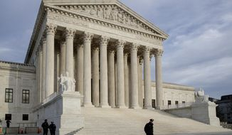 In this Feb. 14, 2017 photo, The Supreme Court is seen at day's end in Washington.  The Supreme Court on Tuesday is hearing an appeal to a case involving a 2010 shooting of a Mexican boy by a U.S. Border Patrol Agent.  (AP Photo/J. Scott Applewhite)