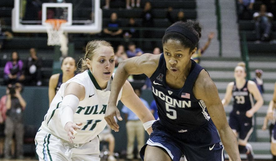 Tulane guard Leslie Vorpahl (11) runs after Connecticut guard Crystal Dangerfield (5) during the second half of an NCAA college basketball game in New Orleans, Saturday, Feb. 18, 2017. (AP Photo/Sophia Germer)