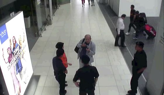 CORRECTS SOURCE - In this image made from Feb. 13, 2017, footage from Kuala Lumpur airport security cameras obtained by Fuji TV, Kim Jong Nam, exiled half-brother of North Korea's leader Kim Jong Un, talks to airport security and officials after he was attacked at Kuala Lumpur International Airport, Malaysia. Kim Jong Nam, the estranged half brother of North Korean ruler Kim Jong Un, died last week after apparently being poisoned in a Kuala Lumpur airport. (Footage from Kuala Lumpur airport security cameras obtained by Fuji TV via AP)