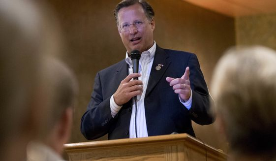 Congressman Dave Brat, R-Va., answers a question during a town hall meeting with the congressman in Blackstone, Va., Tuesday, Feb. 21, 2017. (AP Photo/Steve Helber)