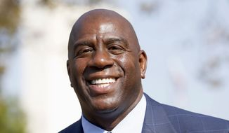 FILE - In a Tuesday, Aug. 23, 2016 file photo, former Los Angeles Lakers star Magic Johnson speaks at a groundbreaking ceremony for a stadium which will be home to the Los Angeles Football Club in Los Angeles. The Los Angeles Lakers fired general manager Mitch Kupchak on Tuesday, Feb. 21, 2017,  and put Magic Johnson in charge of basketball operations in a major shake-up of the struggling franchise's front office.  (AP Photo/Nick Ut, File)