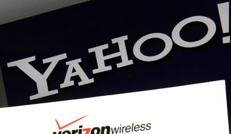 This Monday, July 25, 2016, file photo shows the Yahoo and Verizon logos on a laptop, in North Andover, Mass. (AP Photo/Elise Amendola, File)