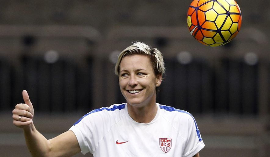 FILE - In this Dec. 15, 2015, file photo, U.S. forward Abby Wambach reacts during a practice session in New Orleans for Wednesday's final U.S. victory tour match, against China. Wambach and Christian writer Glennon Doyle Melton announced their engagement on Feb. 18, 2017. (AP Photo/Gerald Herbert, File)