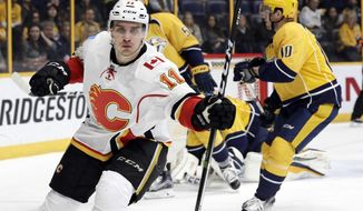 Calgary Flames center Mikael Backlund (11), of Sweden, celebrates after scoring a goal against the Nashville Predators during the first period of an NHL hockey game Tuesday, Feb. 21, 2017, in Nashville, Tenn. (AP Photo/Mark Humphrey)