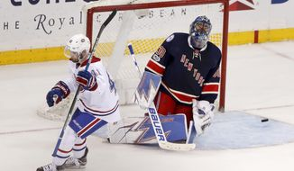 New York Rangers goalie Henrik Lundqvist (30) reacts after Montreal Canadiens left wing Paul Byron (41) scored in the shootout of an NHL hockey game, Tuesday, Feb. 21, 2017, in New York. The Montreal won 3-2. (AP Photo/Julie Jacobson)