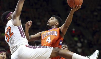 Clemson's Shelton Mitchell (4) scores against the defense of Virginia Tech's Zach LeDay (32) during the first half of an NCAA college basketball game Tuesday, Feb. 21, 2017, in Blacksburg, Va. (Matt Gentry/The Roanoke Times via AP)