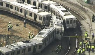 In this image from video provided by WPVI, officials investigate an accident involving out-of-service commuter trains in Upper Darby, Pa., Tuesday, Feb. 21, 2017. The Southeastern Pennsylvania Transportation Authority said the Market-Frankford Line trains were traveling near the 69th Street Transportation Center when the accident occurred. (WPVI via AP)