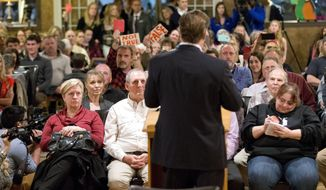 Congressman Dave Brat, R-Va., back to camera, answers questions during a town hall meeting with the congressman in Blackstone, Va., Tuesday, Feb. 21, 2017. (AP Photo/Steve Helber)