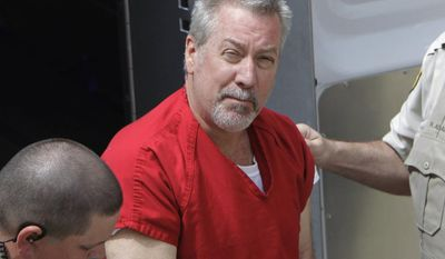 FILE - In this May 8, 2009, file photo, former Bolingbrook, Ill., police officer Drew Peterson arrives for court in Joliet, Ill. Peterson has been transferred out of the Illinois prison system and is now listed in a federal Bureau of Prisons database. Illinois Department of Corrections spokeswoman Nicole Wilson said Tuesday, Feb. 21, 2017 that Peterson had been transferred but declined to say why or where, citing security. (AP Photo/M. Spencer Green, File)
