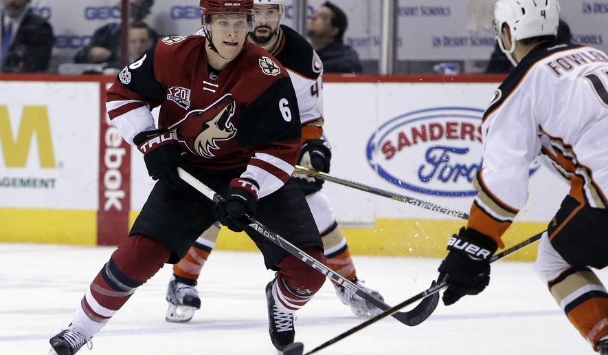 Arizona Coyotes defenseman Jakob Chychrun (6) drives on Anaheim Ducks defenseman Cam Fowler in the second period of an NHL hockey game Monday, Feb. 20, 2017, in Glendale, Ariz. (AP Photo/Rick Scuteri)