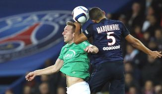 FILE - In this Oct. 25, 2015 file photo, PSG's Marquinhos, right, and Robert Beric of Saint Etienne go up for a ball during their French League One soccer match, in the Parc des princes stadium, in Paris. Saint Etienne willplay Manchester United Wednesday Feb.22, 2017 in a Europa League match. With an estimated budget close to 70 million euros, Saint-Etienne has no equivalent of Ibrahimovic to overturn the deficit against the tournament's favorites. (AP Photo/Jacques Brinon, File)