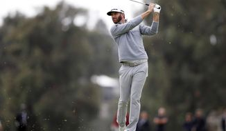 Dustin Johnson hits his approach shot from the fairway on the 18th hole during the third round of the Genesis Open golf tournament at Riviera Country Club, Sunday, Feb. 19, 2017, in the Pacific Palisades area of Los Angeles. (AP Photo/Ryan Kang)