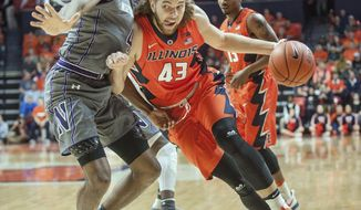 Illinois forward Michael Finke (43) collides with Northwestern forward Vic Law (4) on a drive during the first half of an NCAA college basketball game in Champaign, Ill., Tuesday, Feb. 21, 2017. (AP Photo/Rick Danzl)