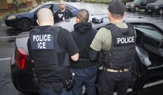 In this photo taken Feb. 7, 2017, released by U.S. Immigration and Customs Enforcement, an arrest is made during a targeted enforcement operation conducted by U.S. Immigration and Customs Enforcement (ICE) aimed at immigration fugitives, re-entrants and at-large criminal aliens in Los Angeles. The Trump administration is wholesale rewriting the U.S. immigration enforcement priorities, broadly expanding the number of immigrants living in the U.S. illegally who are priorities for deportation, according to a pair of enforcement memos released Tuesday, Feb. 21, 2017.  (Charles Reed/U.S. Immigration and Customs Enforcement via AP)