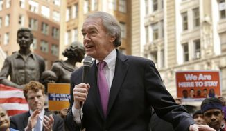"Sen. Ed Markey, D-Mass., front, addresses a crowd as he and Rep. Joseph P. Kennedy III, D-Mass., second from left, join workers, immigrants, and community advocates during a rally called ""We Will Persist,"" Tuesday, Feb. 21, 2017, in Boston. (AP Photo/Steven Senne) ** FILE **"