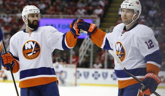 New York Islanders left wing Josh Bailey (12) celebrates his goal against the Detroit Red Wings with Nick Leddy in the first period of an NHL hockey game, Tuesday, Feb. 21, 2017, in Detroit. (AP Photo/Paul Sancya)